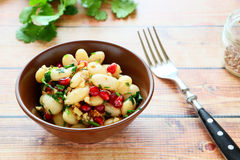 White beans in a salad with cilantro and pomegranate Stock Photo
