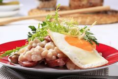White beans with sausage and fried egg Royalty Free Stock Photography