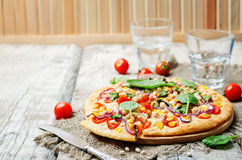 White beans, spinach, corn and tomato pizza with white beans cru. St. toning. selective focus Royalty Free Stock Photography