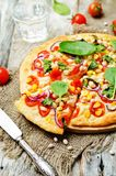White beans, spinach, corn and tomato pizza with white beans cru. St. toning. selective focus Royalty Free Stock Photos