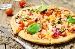 White beans, spinach, corn and tomato pizza with white beans cru. St. toning. selective focus Stock Images
