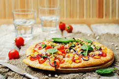 White beans, spinach, corn and tomato pizza with white beans cru. St. toning. selective focus Stock Image
