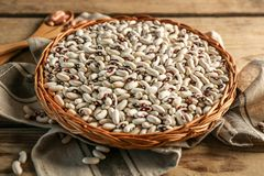 White beans in wicker basket and napkin Royalty Free Stock Photos