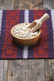 White beans in a wooden bowl Royalty Free Stock Photos