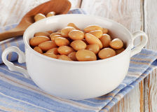 White beans on a wooden table Stock Photography