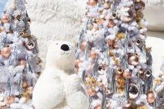 White bear with Christmas tree and snow fall. Cute Christmas bear stock image