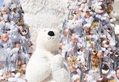White bear with Christmas tree and snow fall. Cute Christmas bear stock photo