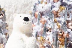 White bear with Christmas tree and snow fall. Cute Christmas bear royalty free stock photo