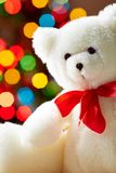 White bear. Image of white soft toy bear on sparkling background stock photo
