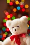 White bear. Image of white soft toy bear on sparkling background stock photography