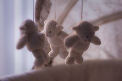 White Bear Plush Toy on Baby Mobile Stock Image