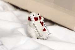 White bear on skis. A toy bear in a scarf, ski, decoration royalty free stock images