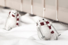 White bear on skis. A toy bear in a scarf, ski, decoration stock images