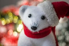 White bear toy as christmas decoration, with santa hat. Royalty Free Stock Photos