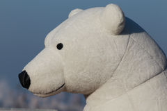 White bear toy. Head of the white bear toy on the blue sky background royalty free stock photo