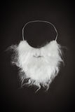 White beard. On a black background with vignette royalty free stock photography