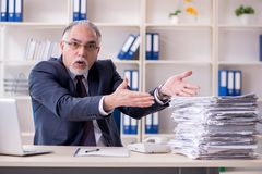 The white bearded old businessman employee unhappy with excessive work. White bearded old businessman employee unhappy with excessive work royalty free stock photography