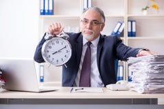 The white bearded old businessman employee unhappy with excessive work. White bearded old businessman employee unhappy with excessive work royalty free stock photos