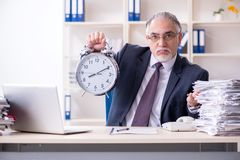 The white bearded old businessman employee unhappy with excessive work. White bearded old businessman employee unhappy with excessive work stock images