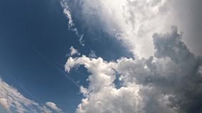 White clouds in the blue sky. White beautiful gray clouds are moving in the blue sky. timelapse stock footage
