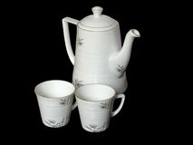 White beautiful tea pot and cups isolated Stock Images