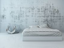 White bed against concrete wall Royalty Free Stock Photo