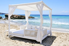 White bed in a beach club in Ibiza, Spain Stock Photography