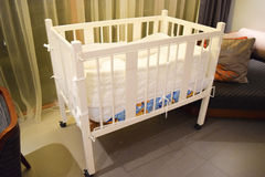 white bed for child and baby at hotel room Royalty Free Stock Photos