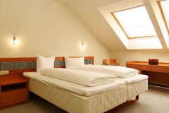 White bed in hotel room Stock Image