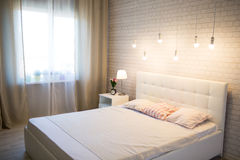 White bed in the interior. Of the bedroom Royalty Free Stock Images