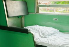 White bed in Interior train with copy space add text.  Royalty Free Stock Images