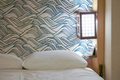 White bed in Japanese hotel room. Royalty Free Stock Photos