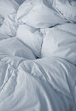 White bed linen in vertical Royalty Free Stock Image