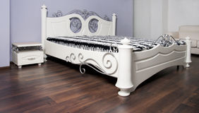 White bed in modernist style Stock Image