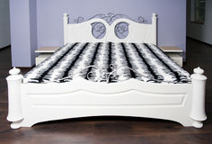 White bed in modernist style Royalty Free Stock Photography
