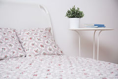 White bed and nightstand Royalty Free Stock Photo