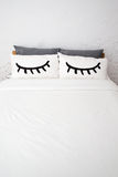 White bed in the room. White bed with pillow eyes Royalty Free Stock Photography