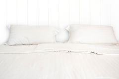 A white bed with 2 pillows in hotel room. A white bed with 2 pillows in room Royalty Free Stock Photo
