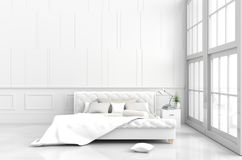 White bed room decor in happy day. White bed room decor with tree in glass vase, pillows, white blanket, window, sky, lamp,bookcase,white wall it is pattern,The Stock Photography