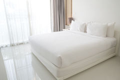 White bed sheets and pillows. Are Organized and  cleanness Royalty Free Stock Photography