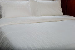 White bed sheets and pillows. Royalty Free Stock Photo