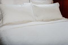 White bed sheets and pillows. Bed set Stock Image