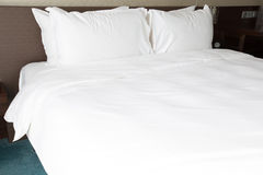 White bed sheets and pillows Stock Image