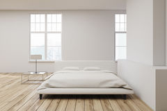 White bed wooden floor Royalty Free Stock Images