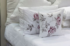 White bedding arrange neatly on white sheets Stock Image