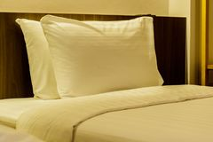 White bedding and pillow in hotel room. Stock Photos