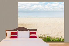 White bedding sheet and pillows on the bed in a room with big window see through beach and blue sky Royalty Free Stock Images