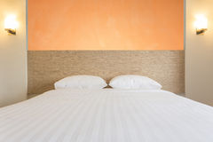 White bedding sheets and pillow in hotel room. Close up white bedding sheets and pillow in hotel room Stock Photography