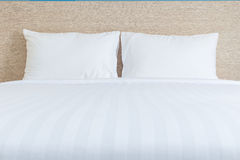 White bedding sheets and pillow in hotel room. Close up white bedding sheets and pillow in hotel room Stock Photo