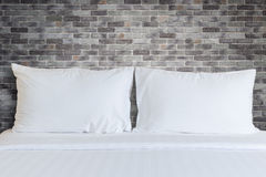 White bedding sheets and pillow in hotel room Royalty Free Stock Image